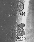 1938: Transitional mark showing both RZM & Squirrel with sword, without original