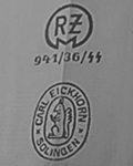 1936: Transitional mark showing both the early double oval and RZM